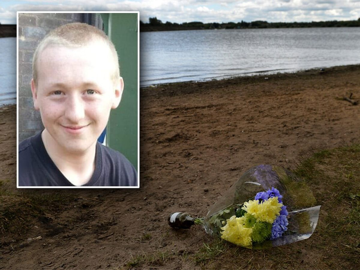 Carl Storer, 21, died after trying to rescue a young girl from Chasewater Reservoir as flowers were left at the scene