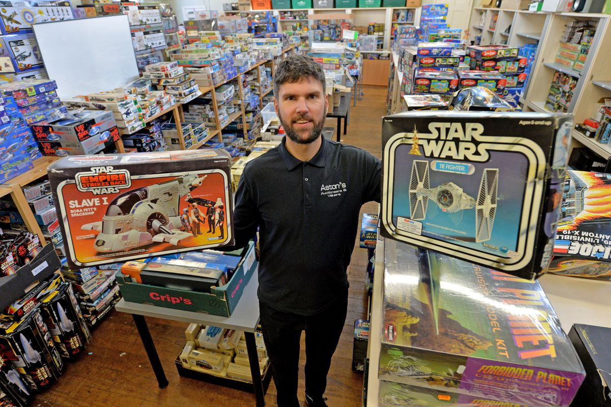 DUDLEY COPYRIGHT TIM STURGESS EXPRESS AND STAR...... 22/10/2020... Astons Auctioneers , Dudley, Star Wars toys auction pre pic this will be the final auction before the new owner takes over. Pictured, Chris Aston  shows only half of the toys , mainly Star Wars, found in a house in Stourbridge which makes up most of this lastest auction..