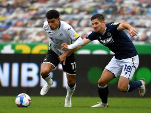 """Swansea City's Morgan Gibbs-White (left) and Millwall's Ryan Leonard battle for the ball during the Sky Bet Championship match at the Liberty Stadium, Swansea. PA Photo. Picture date: Saturday October 3, 2020. See PA story SOCCER Swansea. Photo credit should read: Simon Galloway/PA Wire. RESTRICTIONS: EDITORIAL USE ONLY No use with unauthorised audio, video, data, fixture lists, club/league logos or """"live"""" services. Online in-match use limited to 120 images, no video emulation. No use in betting, games or single club/league/player publications."""