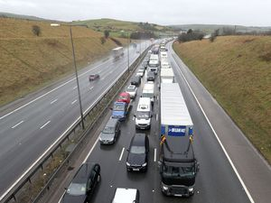 Vehicles queue on the eastbound track of the M62 motorway
