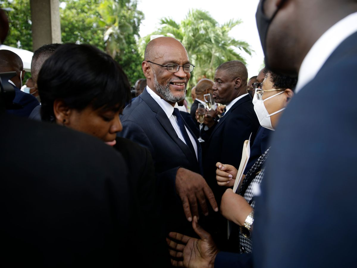 New Haiti prime minister Ariel Henry, centre, talks to members of his cabinet