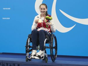 Great Britain's Tully Kearney poses with her gold medal