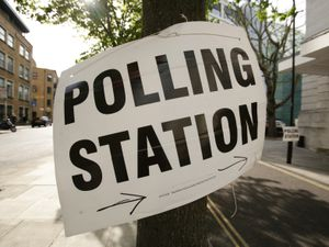 A polling station sign in Hackney in east London (Yui Mok/PA)