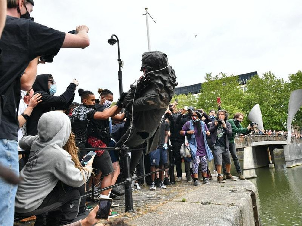 Slave trader statue in United Kingdom city toppled and rolled into harbour
