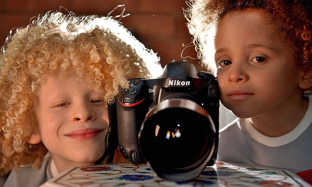 Elijah Enwerem, seven, pictured with his younger brother Erziel, has become a successful child model for many big-name brands
