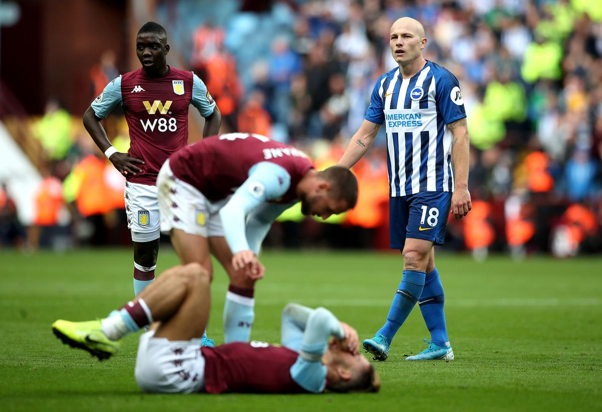 Brighton and Hove Albion's Aaron Mooy appears dejected after fouling Aston Villa's Jack Grealish and being dismissed