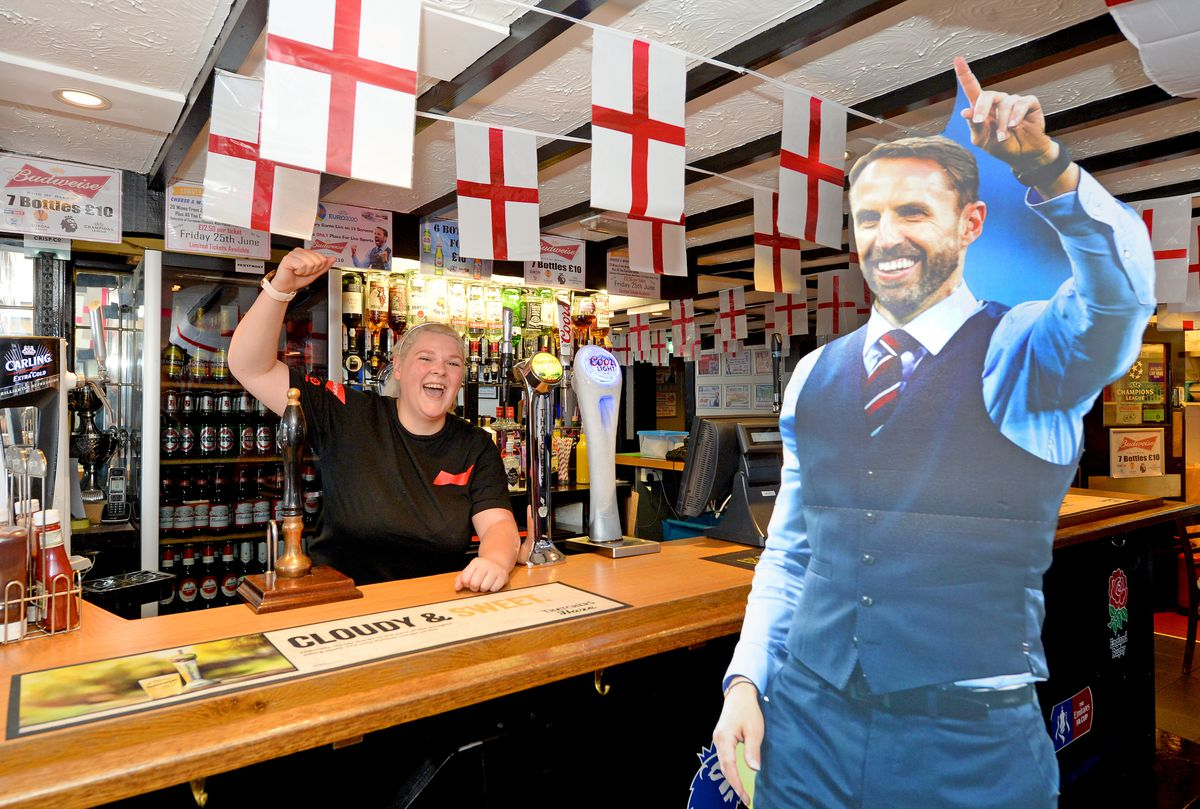 Staff member Vicky Smith looks forward to the games with a cut-out of England manager Gareth Southgate
