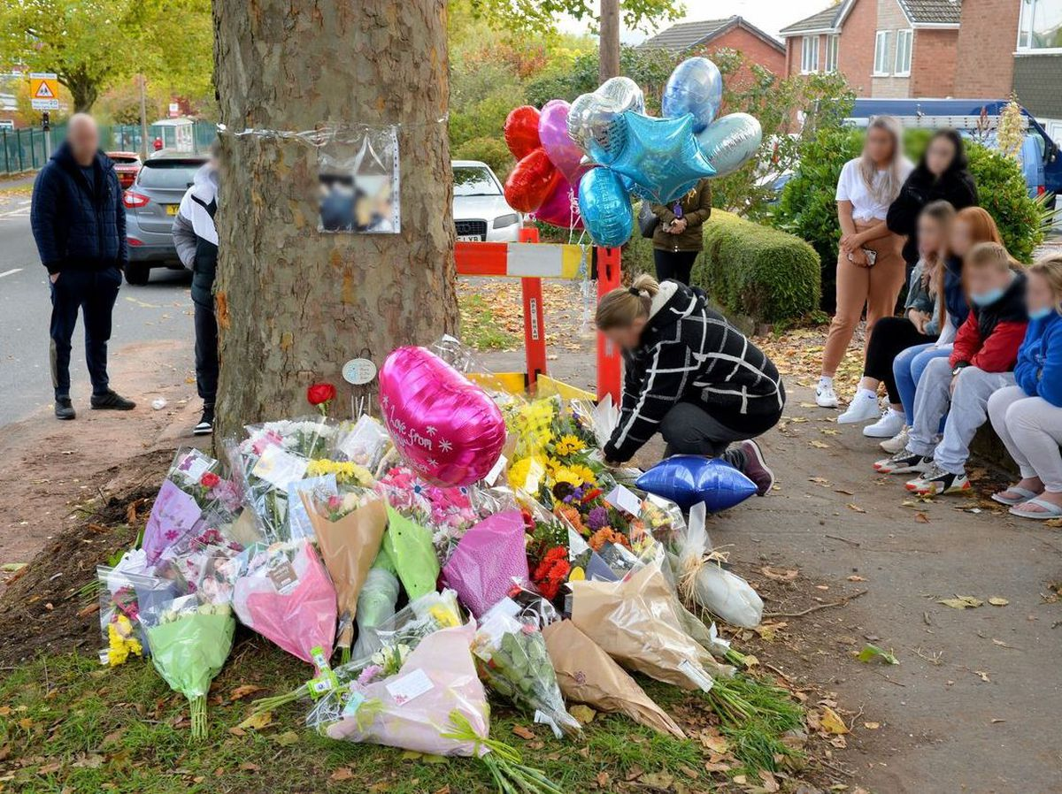 Friends of the young people killed gathered at the scene today to lay flowers and balloons