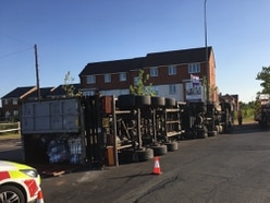 Lorry overturns on island in Burntwood - WATCH