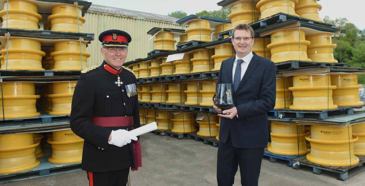 Vice Lord Lieutenant Roger Brunt presents the award to Chris Akers, MD Titan Steel Wheels
