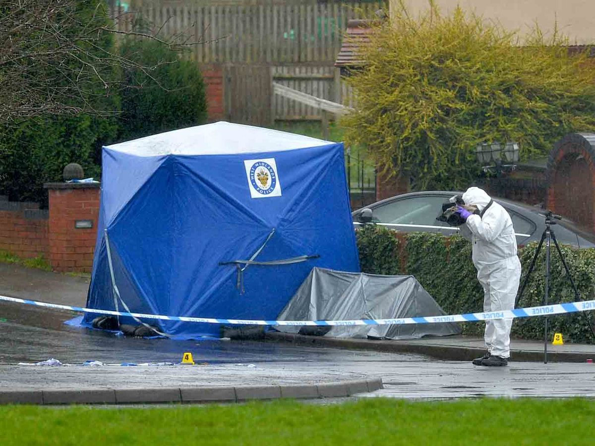A police tent on Wilson Road, just off Pensnett Road, where two men were stabbed to death