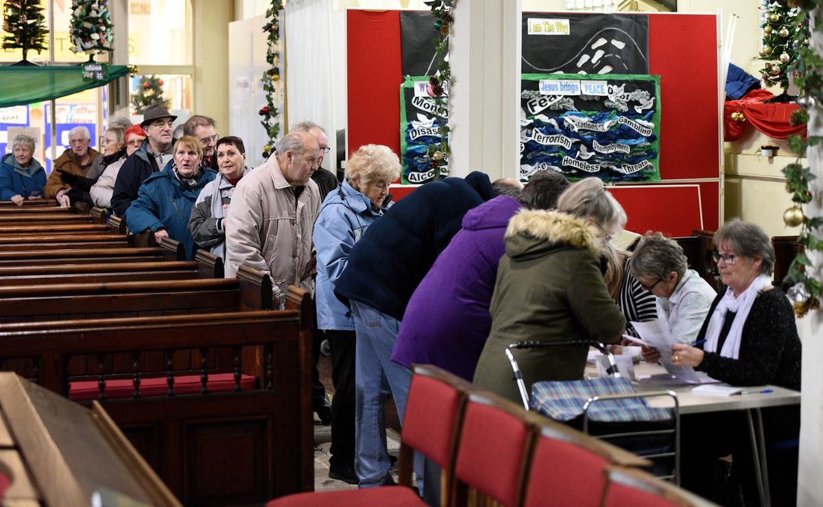 Pensioners in Bilston have been urged to collect £5 Christmas vouchers