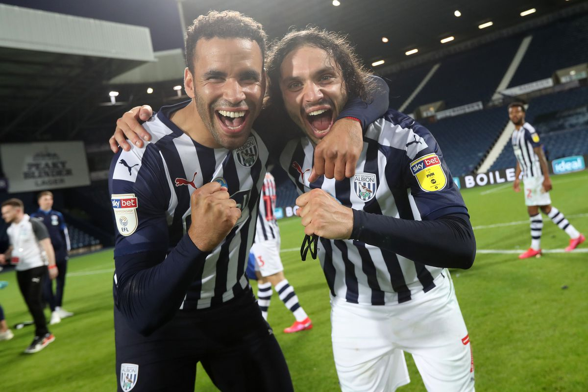 Hal Robson-Kanu of West Bromwich Albion and Filip Krovinovic of West Bromwich Albion celebrate promotion to the Premier League on the pitch at the end of the match. (AMA)