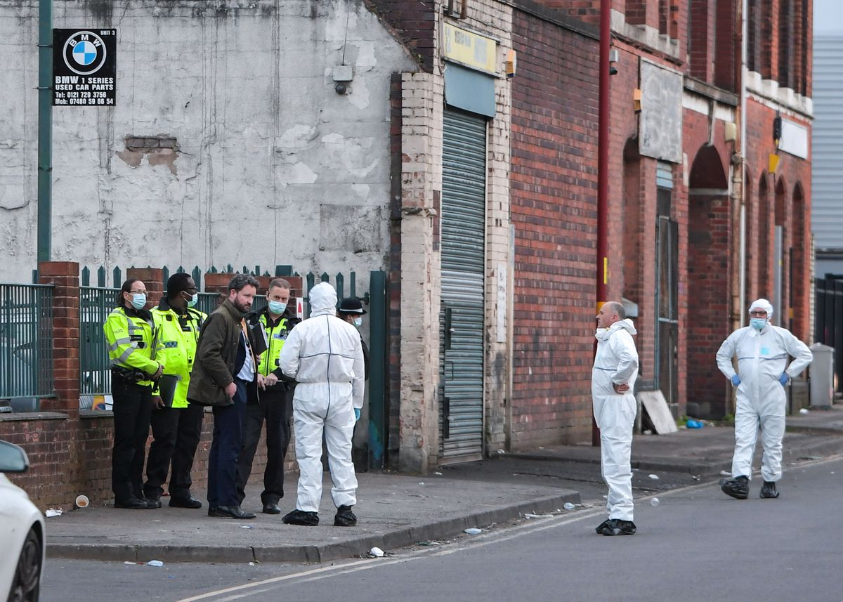 Police in Western Road, near City Hospital, where a man was shot dead. Photo: SnapperSK