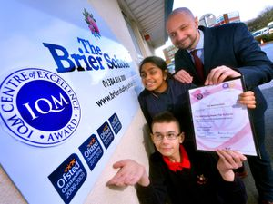 DUDLEY COPYRIGHT EXPRESS AND STAR STEVE LEATH 13/02/2020..Pic at the Brier School, Kingswinford, where they are celebrating after getting their 4th Outstanding OFSTED, a Wellbeing Award and the very top award in the Inclusion Quality Mark, where they have now become a centre of excellence and other schools will look to them to lead the way. Head: David Stanton with pupils: Maryam Ali 14 and Wesley Pearson 13..