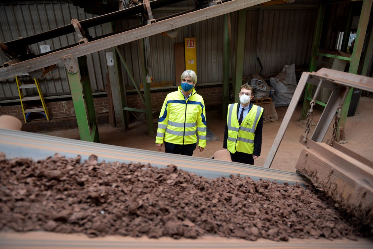 Alex Patrick-Smith (left) with Mayor Andy Street examine raw materials at Dreadnought Tiles' site in Dudley