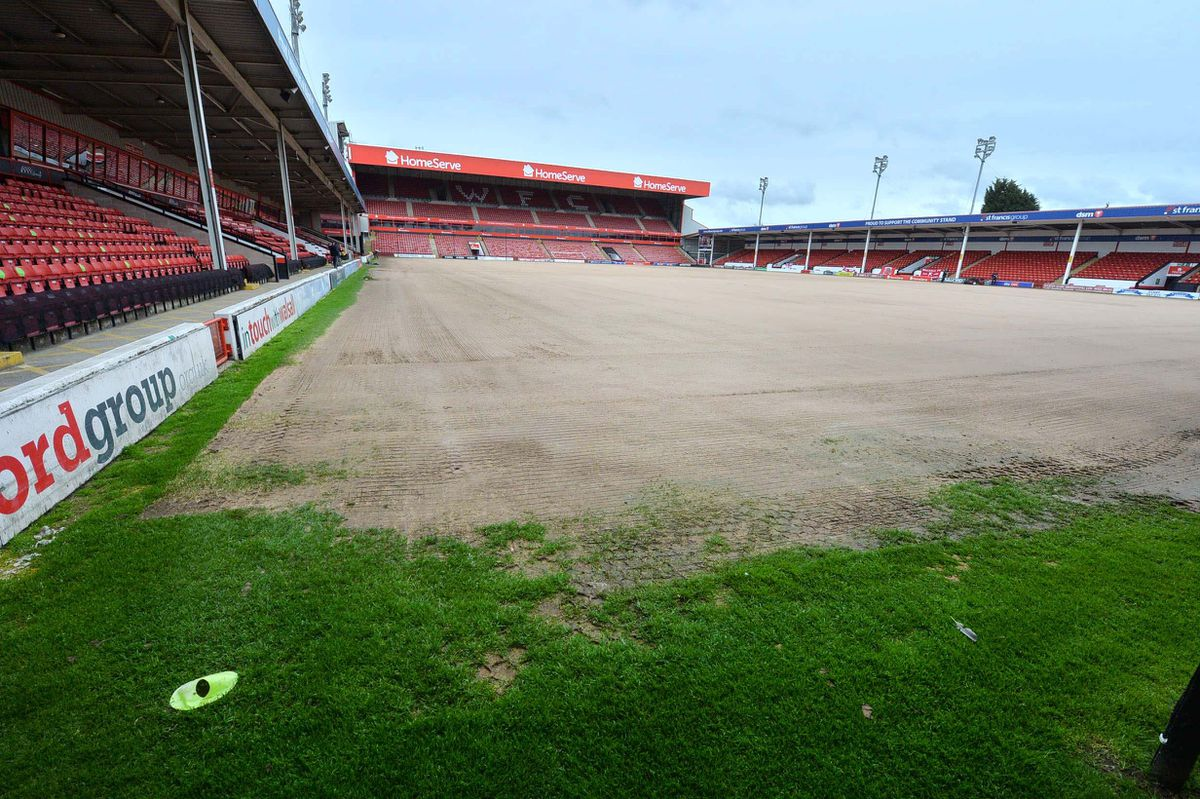 WALSALL COPYRIGHT EXPRESS AND STAR STEVE LEATH 20/05/2021..Walsall FC and MP Therese Coffey  (Secretary of State for Work and Pensions), was visiting to speak to people on the Kickstart scheme. Kickstarter: Jake Lloyd 23 from Wombourne has been helping out groundsman: Paul Mason..