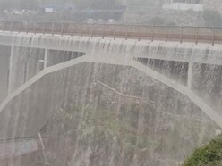 Watch: Storm turns bridge into waterfall in amazing video