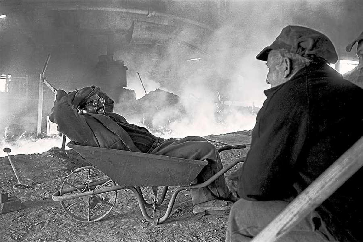 Steel pourers are caught relaxing on camera in 1961 by John Bulmer