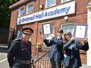 SANDWELL PIC /  DAVID HAMILTON PIC / EXPRESS AND STAR PIC 8/6/21 West Midlands Deputy Lieutenant Gurpreet Bhatia, presents students Oliver Lonsdale, aged 13, and Emily Lonsdale, aged 15, with the Lord-Lieutenants Young Active Citizen Award, at Bristnall Hall Academy, Oldbury..