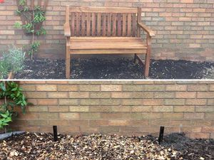 Before and after the bench was stolen