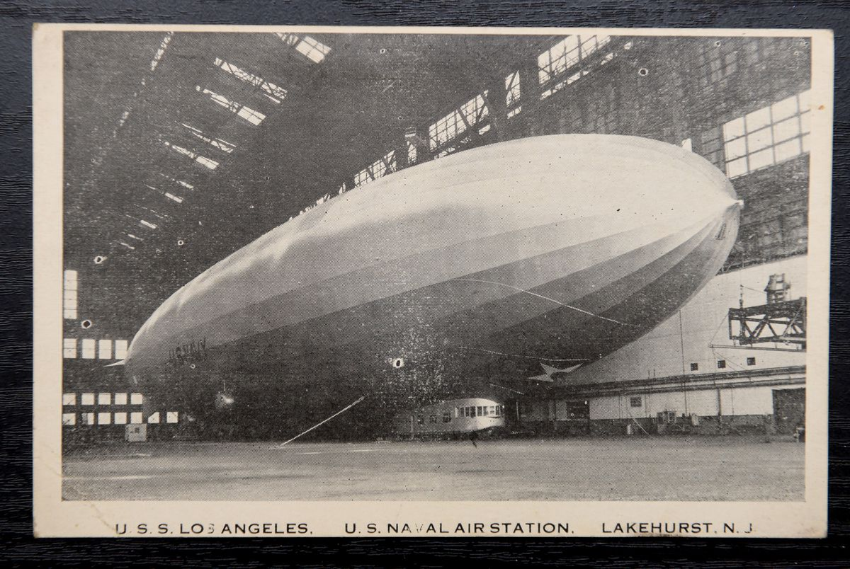 Vintage Mummy antiques shop will auction off items such a postcard of USS Los Angeles, US Naval Air Station from around 1920-30