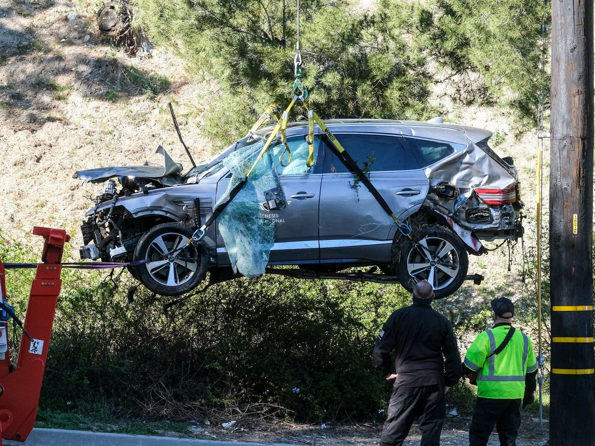 A crane is used to lift the vehicle Tiger Woods was driving in the crash