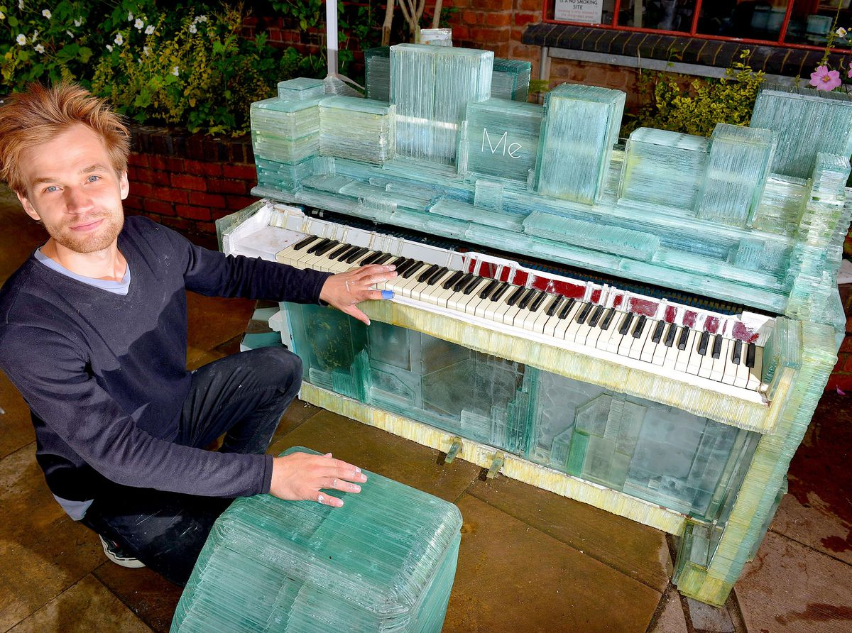 Kārlis Bogustovs with his glass piano in Stourbridge for the International Festival of Glass