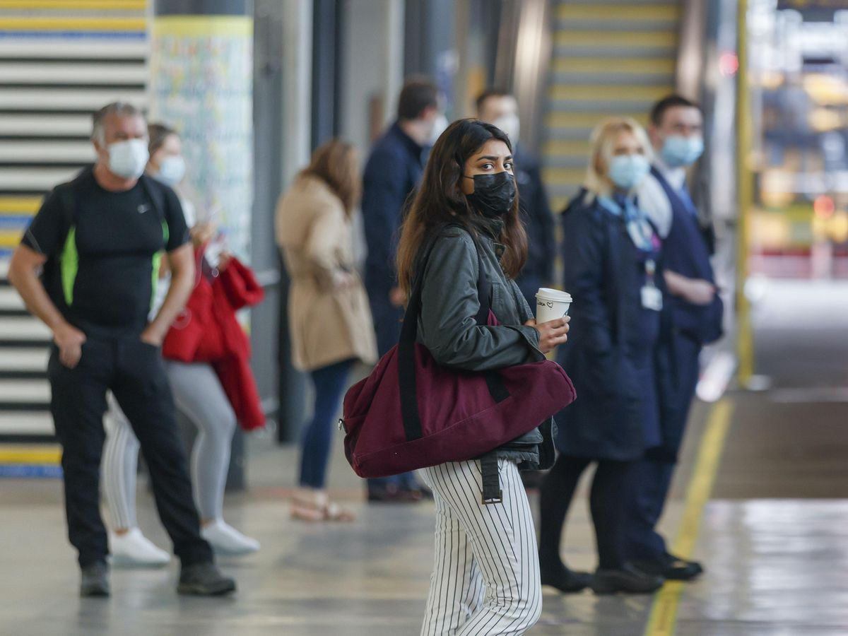 Passengers wearing face masks at Leeds railway station