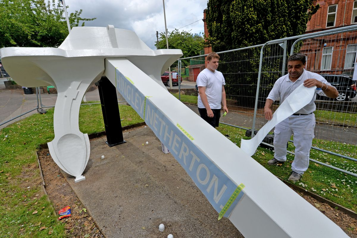 Fencing has gone up around the Titanic Replica Anchor on Northfield Road in Netherton while it is restored. Pictured from Bell group, Josh Mandley and Andy Hohn