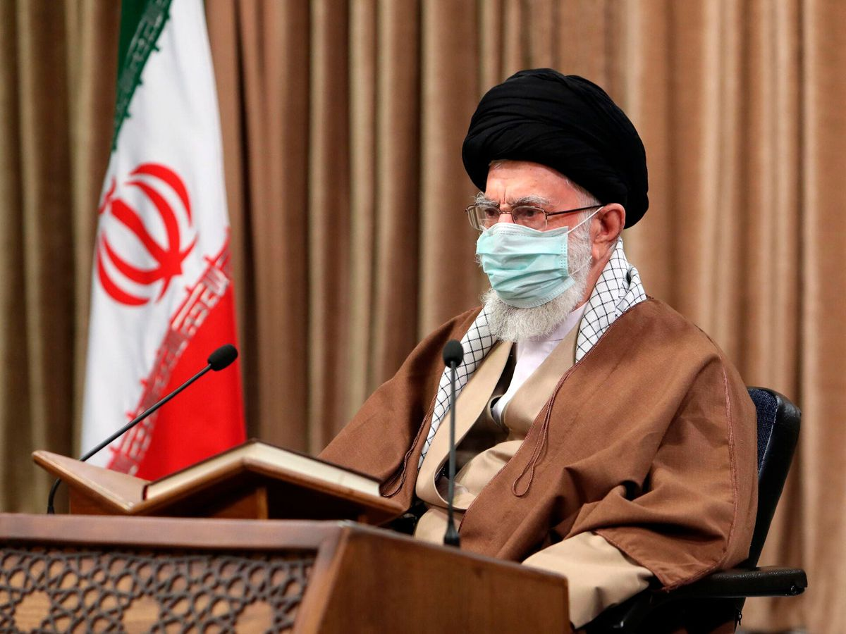 Supreme Leader Ayatollah Ali Khamenei wearing a protective face mask, attends a meeting in Tehran, Iran