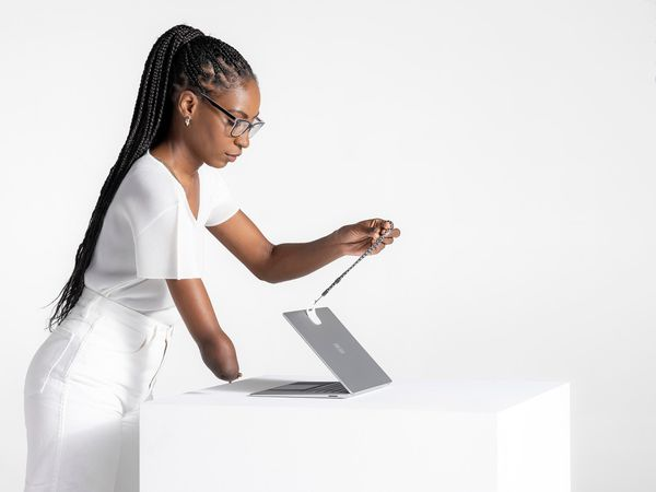 Microsoft's Surface Adaptive kit being used to help open a laptop