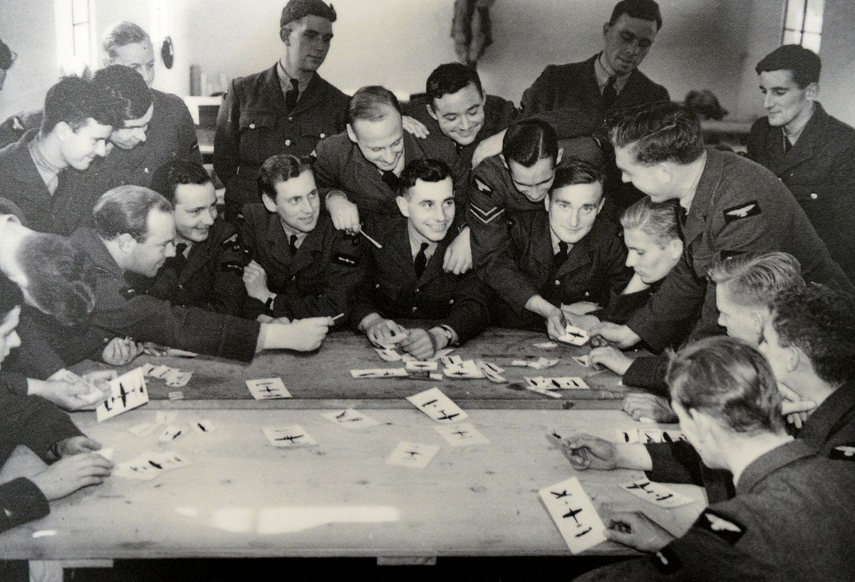Pilots look through aircraft recognition cards, so they can check the differences between friend or foe.
