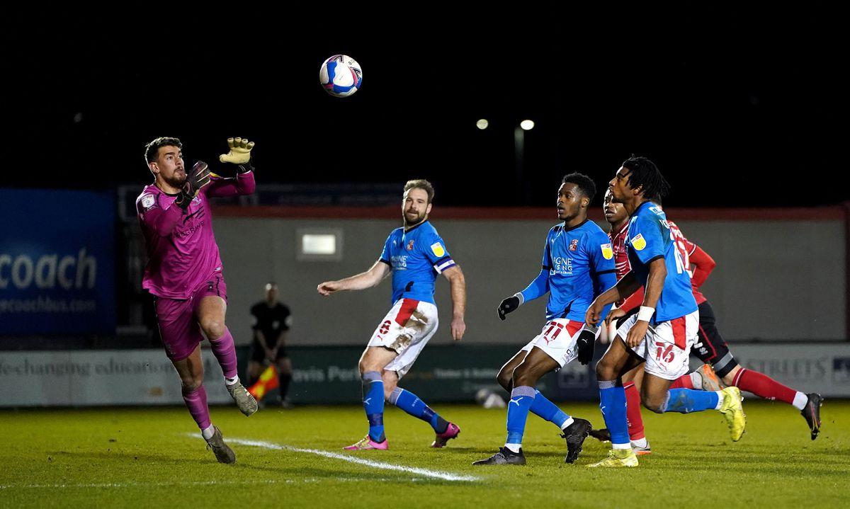 Lincoln City's Alex Palmer saves a shot on goal