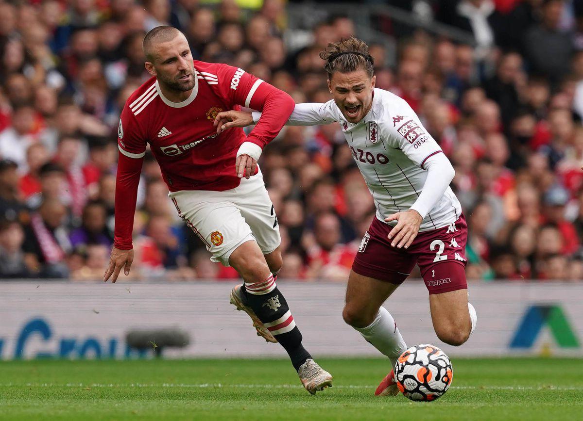 Manchester United's Luke Shaw (left) fouls Aston Villa's Matty Cash
