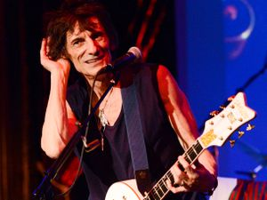 Musician Ronnie Wood of the Rolling Stones performs with guitarist Mick Taylor, drummer Simon Kirke and keyboardist Al Cooper in a rare club appearance at The Cutting Room on Thursday, Nov. 7, 2013 in New York. (Photo by Evan Agostini/Invision/AP).