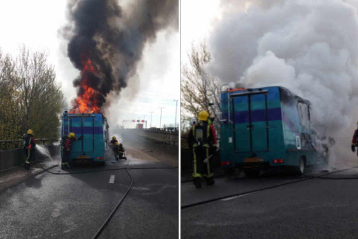 Blaze tears through campervan closing M6 slip road