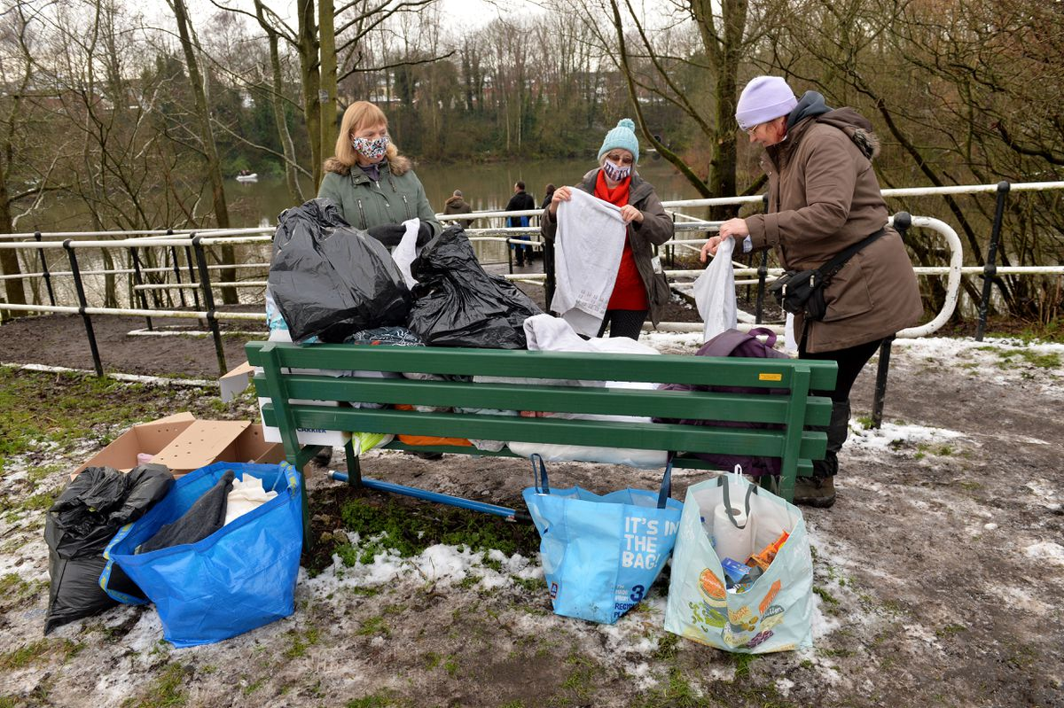 Local volunteers with towels ready for captured birds
