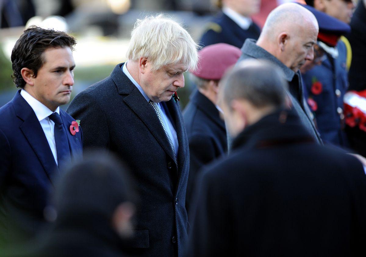 Boris Johnson with Johnny Mercer, left