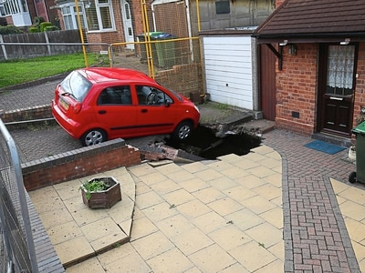Driveway sinkhole is now 12ft-deep chasm