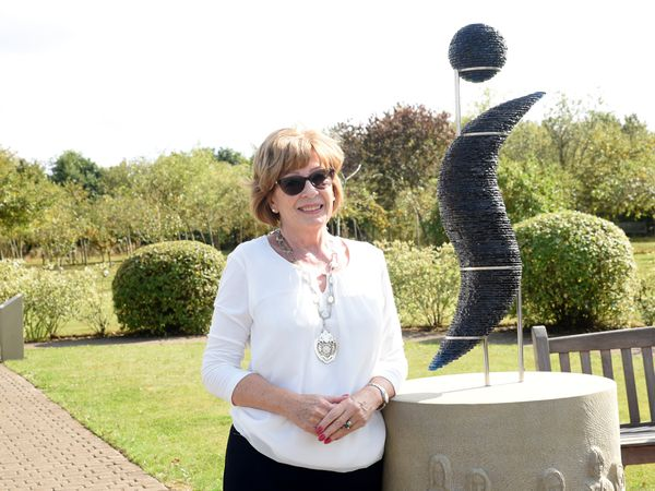 Cathy Cottridge, Federation President of Soroptimist International Great Britain and Ireland, with the sculpture at the National Memorial Arboretum.