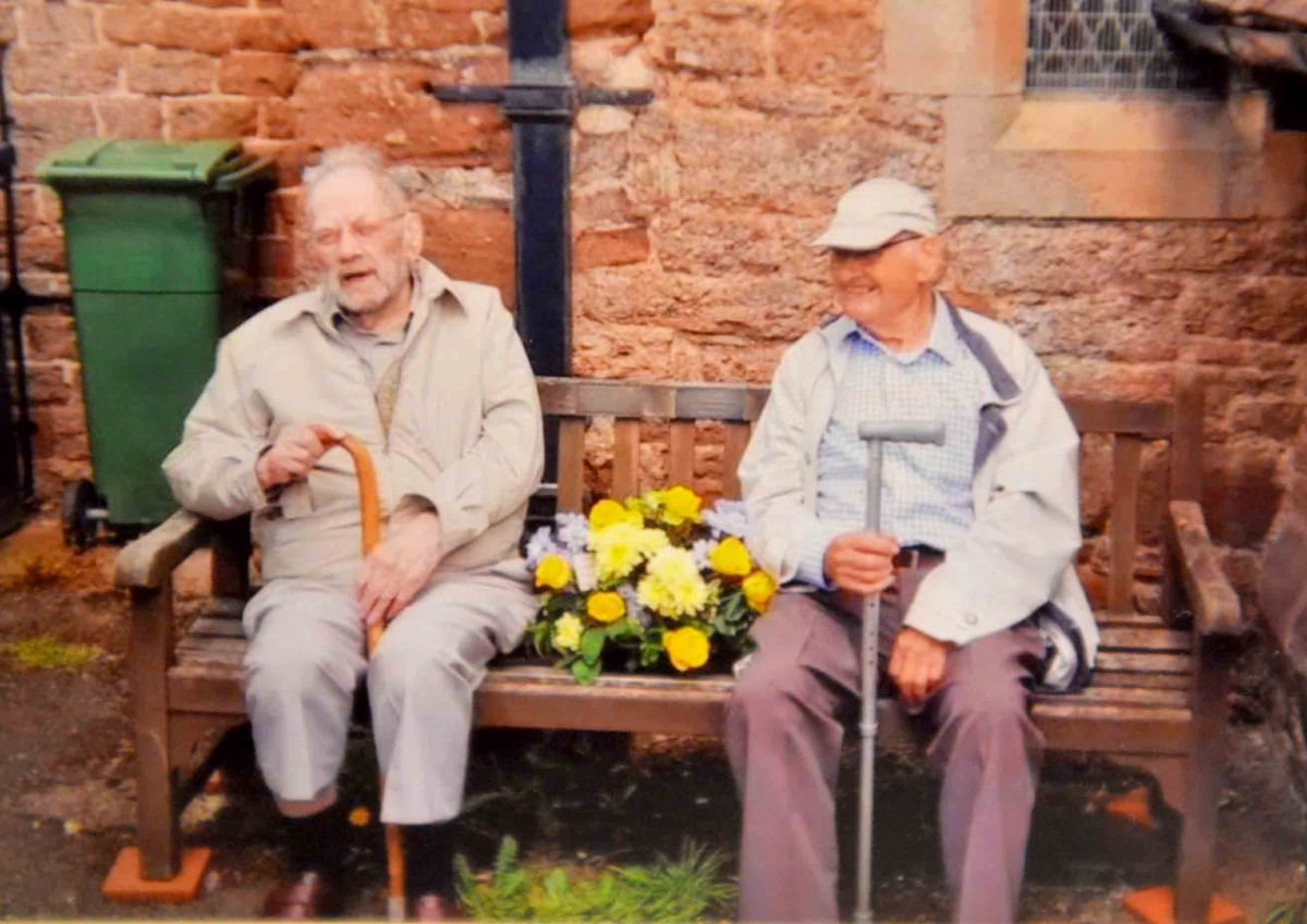 Ron and Roy Tomlin on the memorial bench in Ford dedicated to their mother Florence and sisters