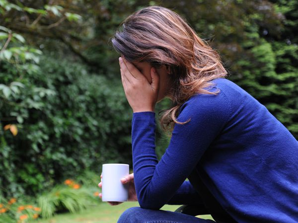 Picture posed by a model of a woman showing signs of depression