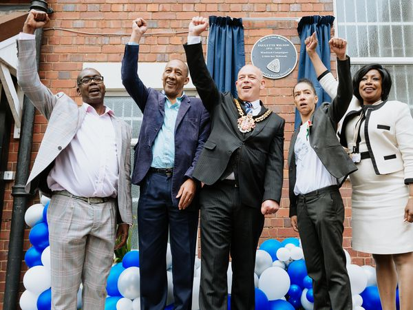Mayor of Wolverhampton, Councillor Greg Brackenridge with friends and family of Paulette at the unveiling of the blue plaque