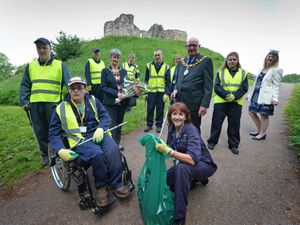 Litter picking at Stafford Castle, students and support workers from Futures @ South Staffordshire College, with (centre) mayoress of Stafford Hazel Nixon, mayor of Stafford councillor Tony Nixon, (right) councillor Carolyn Trowbridge, and (front) tutor Melanie Edge