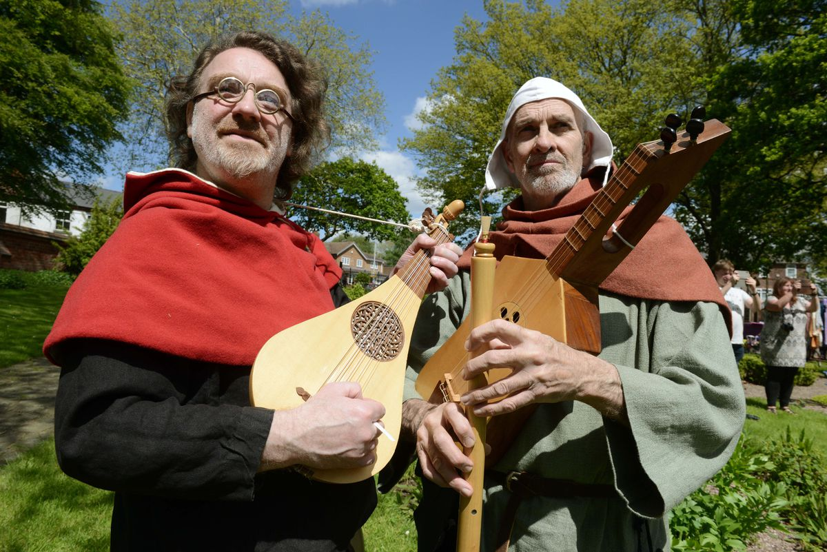 Ian Pittaway, left and Andy Casserley from Night Watch entertain the crowds at the Green Man Festival at Oak House Museum, Oak Road, West Bromwich