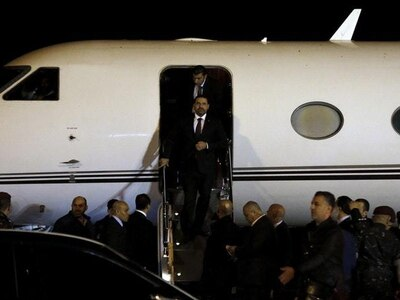Lebanon's Hariri due to attend military parade after returning to Beirut