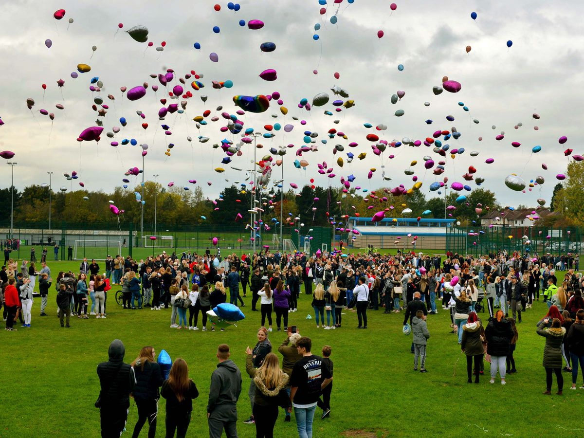 Balloons are released into the sky at Dell Stadium