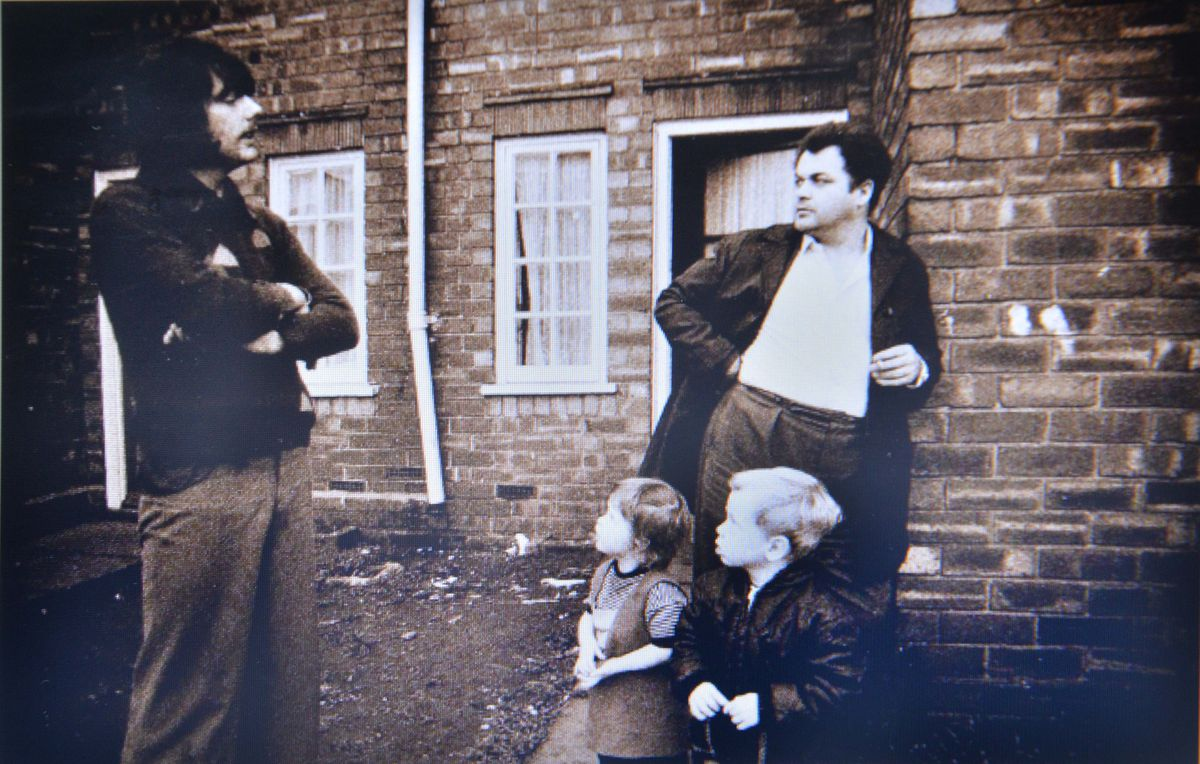 Peter Sheard, left, pictured talking to Henry Smith, who was with his young children Joanne and Malcolm