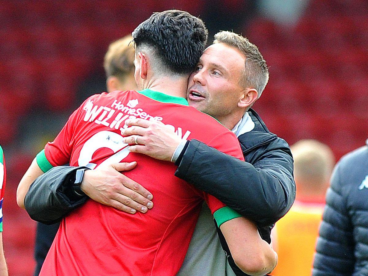 Matt Taylor congratulates Conor Wilkinson.